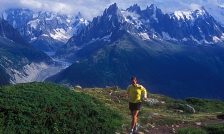 A woman trail-runs in the mountains above Chamonix, France.