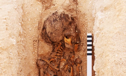 A juvenile burial under excavation at the North Tombs Cemetery, Amarna, Egypt