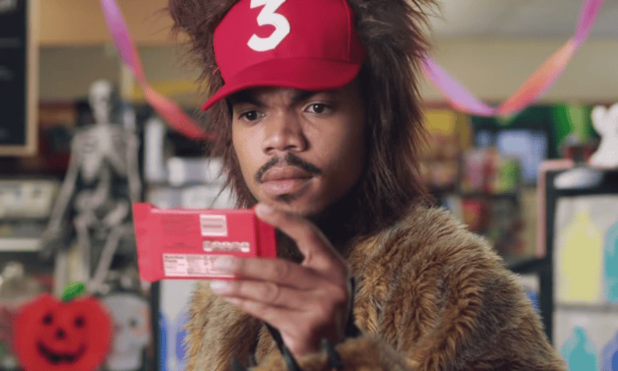 Chance the Rapper studying a Kit-Kat.