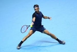 Federer hits a forehand.