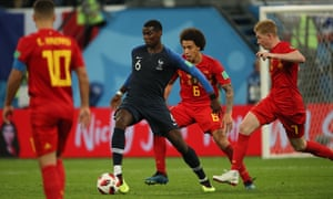 Paul Pogba retains possession despite the attentions of Belgium's Axel Witsel and Kevin De Bruyne in France's semi-final victory