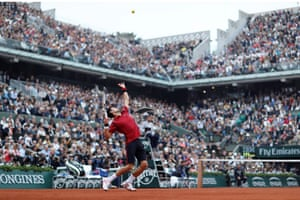 Djokovic serves.