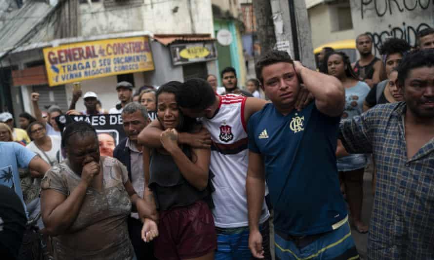 Daniele Felix, centre, protests against the death of her niece, Ágatha Félix, in the Complexo do Alemão favela in Rio.