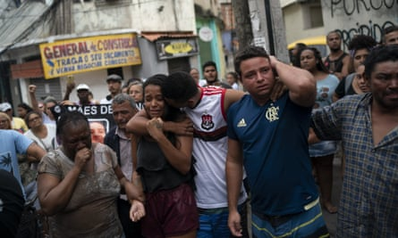 Daniele Felix, centre, protests against the death of her niece, Ágatha Félix, in the Complexo do Alemão favela in Rio.
