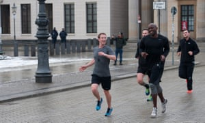 Mark Zuckerberg running through Berlin with his bodyguards in 2016.