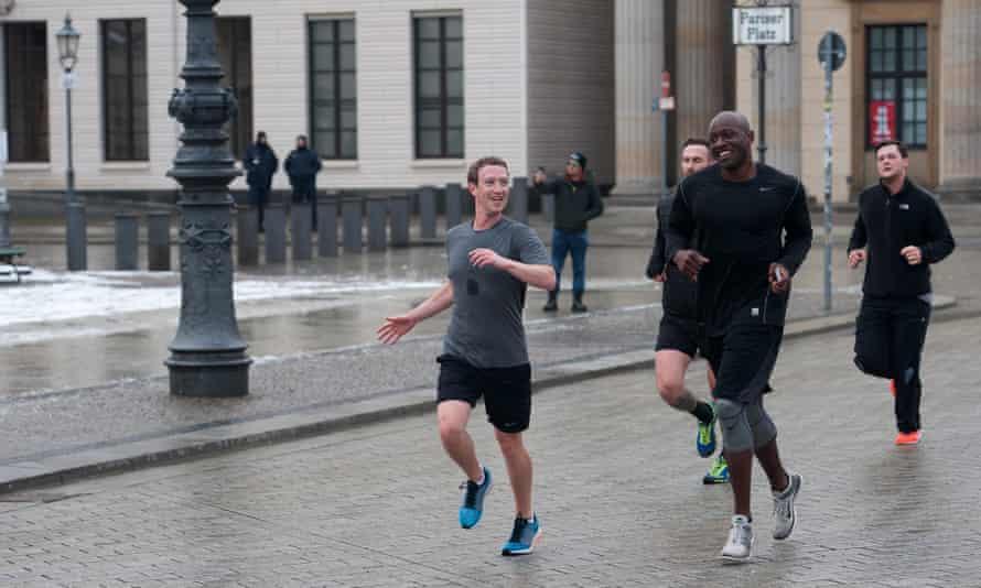 Mark Zuckerberg running through Berlin with his bodyguards in 2016.