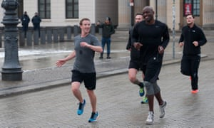 Mark Zuckerberg out running with Ime Archibong (Facebook's vice-president of product partnerships) and bodyguards in Berlin in 2016. Personal security topped his 2018 security costs.