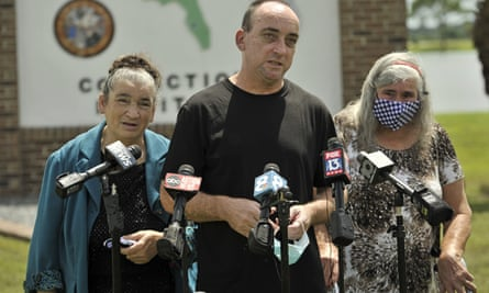 Robert DuBoise, 55, meets reporters with his sister Harriet, left, and mother Myra, outside the Hardee county correctional institute after his release on 27 August in Hardee county, Florida.