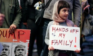 A young girl with protesters in LA to denounce the US travel ban from Muslim-majority countries.