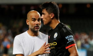 Manchester City's Pep Guardiola gives instructions to their record signing, Rodri.