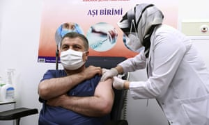 Turkey's health minister Fahrettin Koca receives the first jab after Turkish authorities gave the go-ahead for the emergency use of the Covid-19 vaccine produced by China's Sinovac