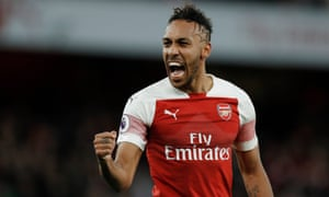 Arsenal's Pierre-Emerick Aubameyang celebrates after scoring his side's opening goal from the penalty spot at the Emirates Stadium in London.