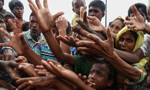 Hungry Rohingya refugees wait for food at the Kutupalong border camp in Bangladesh.