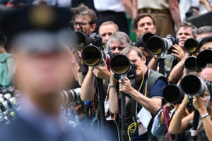 Photographers aim their lenses at the royal box