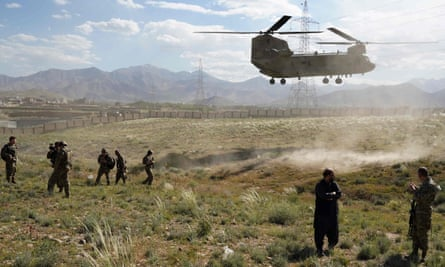 A US military helicopter lands in Afghanistan. A Hazara interpreter who provided translation assistance to allied forces in Afghanistan and had to flee the country as a refugee, is now facing indefinite detention in Australia.