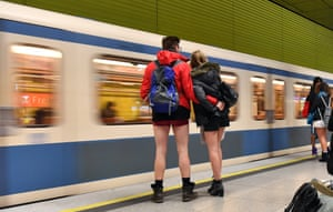 A group of people wearing only underpants wait for the subway at the 'Muenchner Freiheit' station during the 'No Pants Subway Ride' in central Munich, Germany