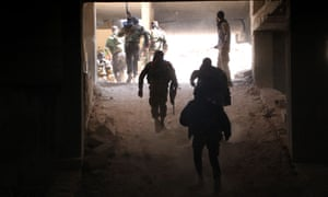 Rebel fighters from the Jaish al-Fatah brigades get into position at an entrance to Aleppo