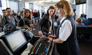 Passengers check-in in for a United Airlines flight in Chicago. United doesn't use facial recognition technology.