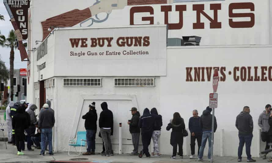 People wait in line outside the Martin B Retting gun store in Culver City on 15 March.