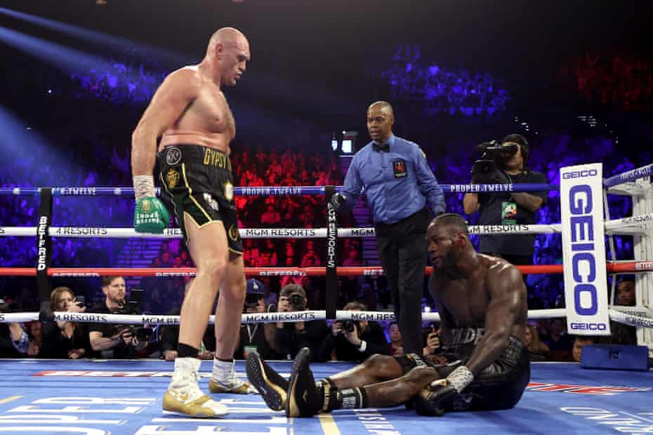 Tyson Fury knocks down Deontay Wilder in the fifth.