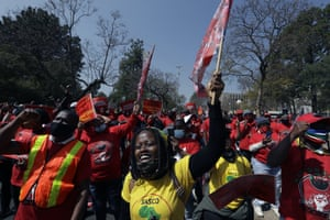 Members of the National Education, Health and Allied Workers' Union protest at the government's Union Buildings in Pretoria, South Africa.