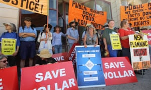 "Group of protesters against Peabody's Wilpinjong coalmine with ""Save Wollar"" signs"