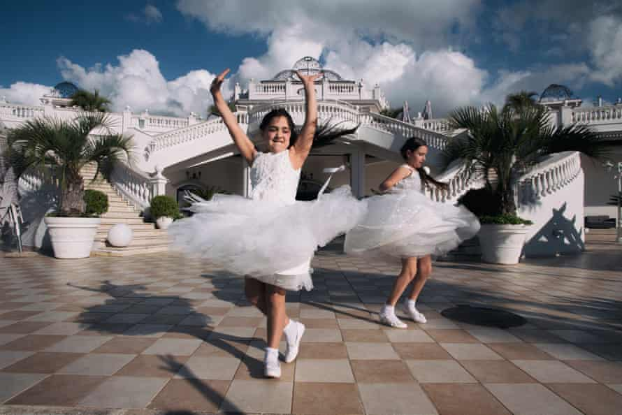 Eleonora and Giusy play and dance at the Princess Royal Palace in Telese during the party for their first communion