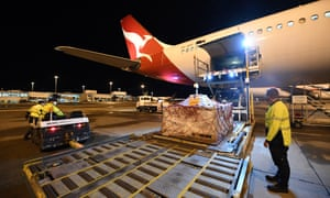 Pfizer vaccines are unloaded off a Qantas flight on Sunday. Australia has secured an additional 4 million doses of the Pfizer vaccine in a swap with the United Kingdom.