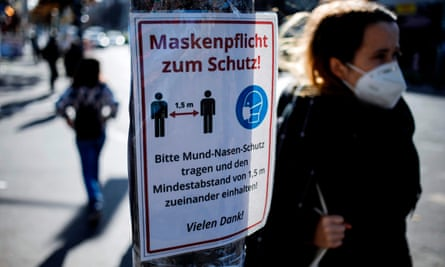 'Masks required for protection': a sign requesting the wearing of face masks and pointing out social distancing rules in Berlin's Kreuzberg district earlier this month.