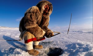 An Inuit man fishing on Baker Lake in Nunavut, Canada.