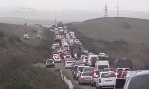 People fleeing Nagorno-Karabakh to Armenia on Saturday as Azerbaijani forces advanced into the enclave.