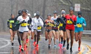 Elite competitor's take part in the women's race at a rain-drenched Boston Marathon.