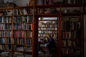 My mother surrounded by her huge collection of books that she has read over her lifetime