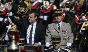 Emmanuel Macron and Pierre de Villiers drive down the Champs Elysees avenue during Bastille Day parade.