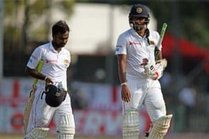 Suranga Lakmal and Malinda Pushpakumara walk of the pitch disappointed as England win the series.