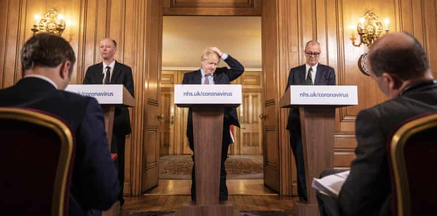 Boris Johnson gives a press conference on the coronavirus pandemic with chief medical officer Chris Whitty and chief scientific officer Sir Patrick Vallance on 16 March