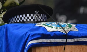 A policeman's hat sits on top of the coffin of PC David Phillips