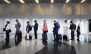 Passengers at O'Hare International airport in Chicago wait in line to be screened at a Transportation Security Administration (TSA) checkpoint.