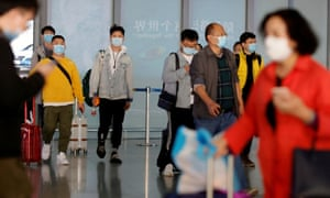 People wearing protective face masks against the coronavirus arrive at Capital Airport in Beijing, China, 5 November 2020.