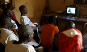 Ivorians watching the trial on television