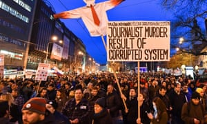Protesters holds placards during a rally to pay tribute to the murdered Slovakn journalist Ján Kuciak.