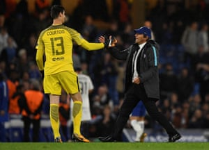 Conte celebrates with Courtois after the final whistle.