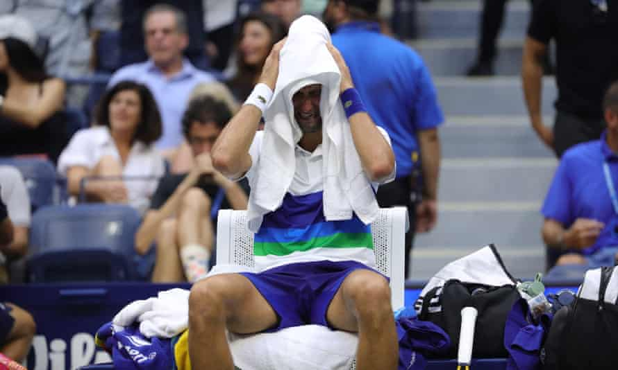 Novak Djokovic is overcome with emotion during the changeover before Daniil Medvedev served for the title.