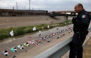 Ciudad Juárez, Mexico: People take part in a yoga class near the border wall next to the Rio Grande river