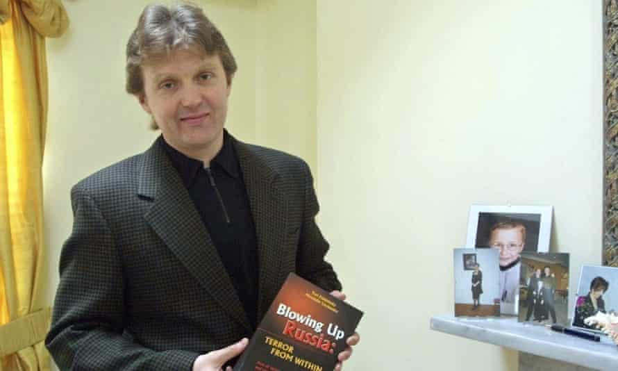 Alexander Litvinenko in May 2002 holding a copy of his book Blowing Up Russia: The Return of the KGB