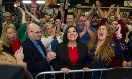 Sinn Féin supporters cheer leader Mary Lou McDonald (in the red dress) at the Dublin City count centre.
