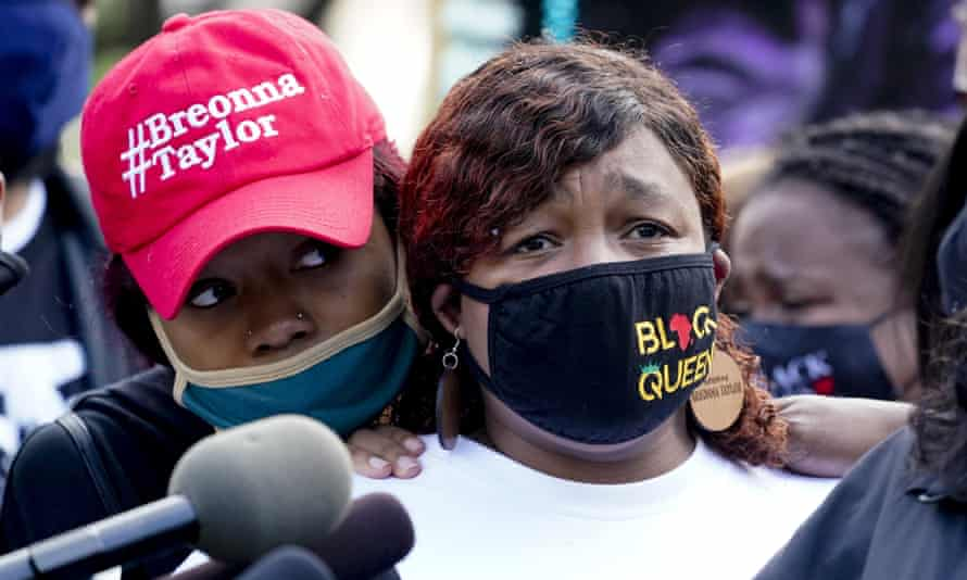Tamika Palmer, the mother of Breonna Taylor, listens to a news conference, in Louisville, Kentucky.