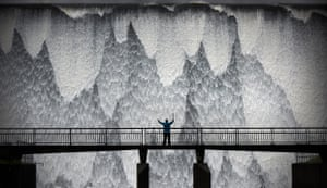 Jeff Overs: Wet Sleddale Reservoir  Cumbria, England  A hiker salutes the Wet Sleddale Reservoir as it overflows down the 21m-high dam wall, creating a wall of water following heavy rain and high winds. After a previous and unsuccessful visit to the location, a late-night text message from the local farmer, who I had befriended, read 'overflowing!' That sent me hurtling up the M6 before dawn the next morning. On arrival, the farmer was busy with his sheep but a hiker walked into frame. It was raining and blowing so hard I could barely steady the camera. Living the view, adult class, shortlisted