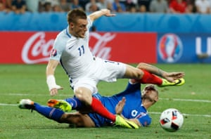 Ragnar Sigurdsson's well-timed tackle stops Vardy.