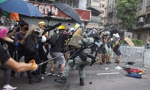 Protesters clash with police in Yuen Long district.